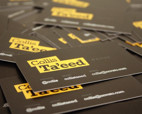 Stack of black and yellow business cards