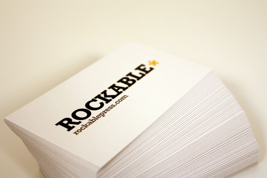 Stack of white business cards on white background